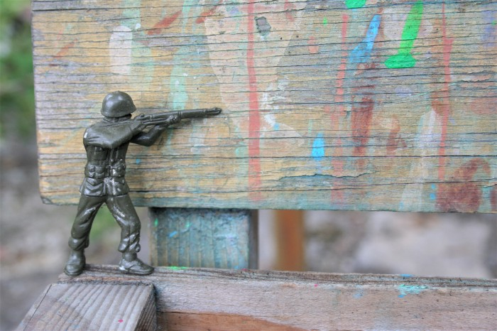 little green toy soldier with rifle