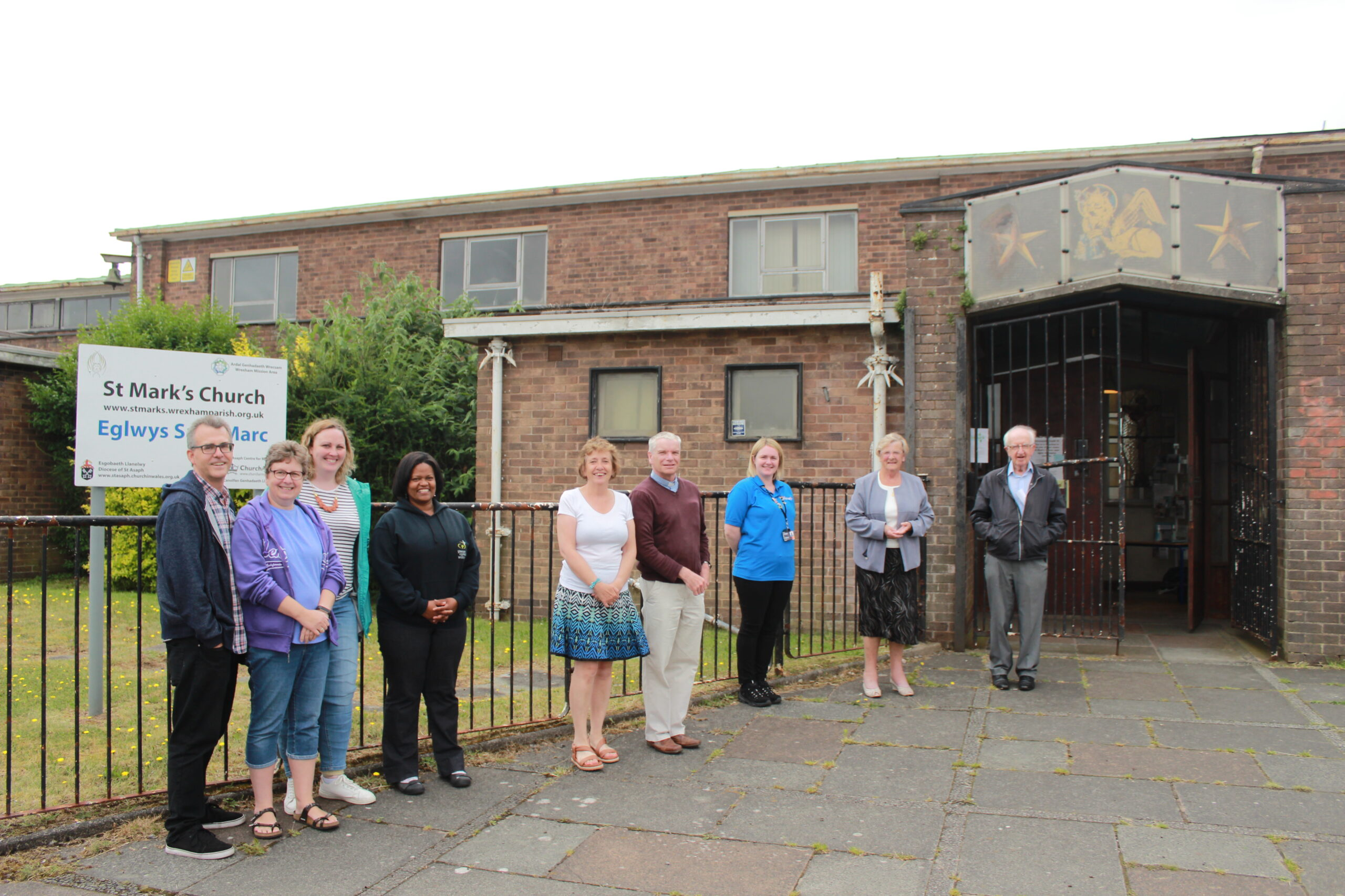 The St Mark's project team outside the church